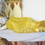 Reclining Buddha in a golden robe — Stock Photo