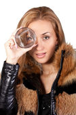 Young brunette model with a glass — Stock Photo