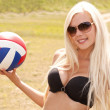 Joyful blond girl in black bikini with a ball outdoor — Stock Photo