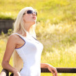 Young beautiful blond girl in sun glasses outdoor — Foto Stock