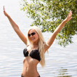 Sweet blond girl in bikini on the beach - Lizenzfreies Foto