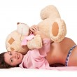 Sweet young pregnant lady holding a toy — Stock Photo #12647777