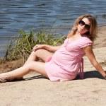 Pretty pregnant girl on the beach — Stock Photo #12647820