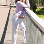 Pretty pregnant girl on the bridge — Stock Photo #12647860