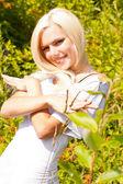 Joyful blond woman in a stylish white dress — Stock Photo