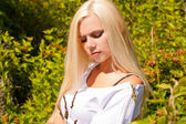 Stylish blond woman in white dress outdoor — Stock Photo
