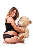 妊娠中の女の子のおもちゃの笑みを浮かべてください。 — ストック写真