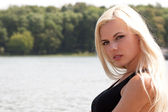 Young gorgeous blond woman at the lake — Stock Photo