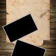 Blank paper roll and old photos - Stock Photo