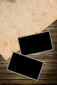 Old photo frames and paper on a dark wooden background — Stockfoto