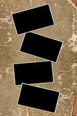 Multipal photo frames on a weathered paper background — Stock Photo