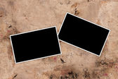 Empty photo frames on a grungy paper background — Stock Photo