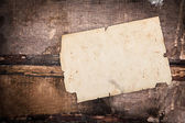 Faded old paper on a grungy background — Stock fotografie