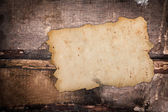 Faded old paper on a grungy background — Stock Photo