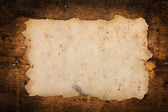 Faded old paper on a grungy background — Stok fotoğraf