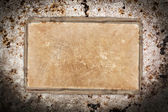Weathered old paper sheet on wood — Stock Photo