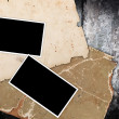 Rotten old papers and blank photo frames — Stock Photo
