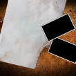Torn old paper and photo frames — Stock Photo