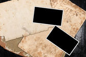 Empty photo frames on old paper — Stock Photo