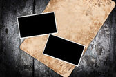 Weathered paper and photo frames — Stock Photo