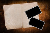 Damaged old paper and empty photo frames — Stock Photo