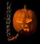 Halloween pumpkin with smoke pipe a — Stock Photo