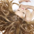 Beautiful young woman with wonderful hair — Stock Photo