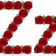 Alphabet made from red roses and green leaves — Stock Photo