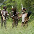 Unidentified warriors of a Papuan tribe - Stock Photo