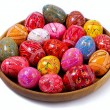 Ukrainian Easter Colorful Eggs in a wooden plate — Stock Photo #22850566