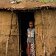 Maasai child near traditional hut — Stock Photo