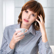 a businesswoman drinking coffee at office  — Stock Photo