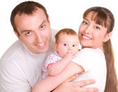 Father and mother are holding their baby — Stock Photo