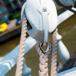 Pulley with ropes on deck of ship — Stock Photo