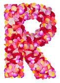 Bokstaven r tillverkad av färgglada kronblad rose — Stockfoto