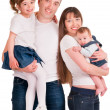 A father and mother are holding two their daughters — Stock Photo #30162623