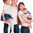 A father and mother are holding two their daughters — Stock Photo