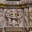 Stone carved erotic bas relief in Hindu temple in Khajuraho, India — Stock Photo #33357095