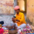 Stock Photo: Snake charmer in Amber Fort in Jaipur, India.
