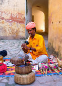 Snake charmer in Amber Fort in Jaipur, India. — Stock Photo