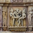 Stone carved erotic bas relief in Hindu temple in Khajuraho,  In — Stock Photo
