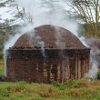 African hut for the production of charcoal — Stock Photo