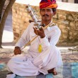 Indian musician in traditional dress playing musical instruments — Stock Photo