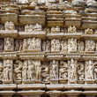 Stone carved erotic bas relief in Hindu temple in Khajuraho — Stock Photo