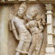 Stone carved erotic bas relief in Hindu temple in Khajuraho — Stock Photo #36267533