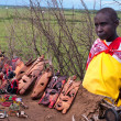 Постер, плакат: Woman sells traditional souvenirs at Maasai Mara Kenya