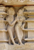 Stone carved erotic bas relief in Hindu temple in Khajuraho, India — Stock Photo