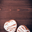 Homemade ginger cookies heart shaped over wooden table. — Stock Photo