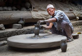 Nepalese  potter working in pottery workshop — Stock Photo