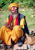 Sadhu with traditional painted face — Stock Photo
